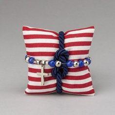 Rosario elastico blu e argento con cuscino in cotone a righe bianche e rosse