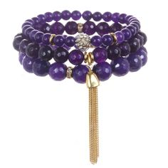 As seen in O, The Oprah Magazine! Set of 3 Color Karma semi-precious beaded stretch bracelets with crystal and 22K gold-dipped accents. Available with tassel or gem pendant. Symbolizing introspection, imagination and dreams, purple expands the unconscious, inspiring you to see beyond this world.