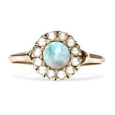 Yep, I like the pearls on this one, and the blue opal and the size. Actually, I sort of want this one.