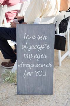 "Wedding signage, white calligraphy, aisle décor, beach wedding, ""In a sea of people my eyes always search for you."""