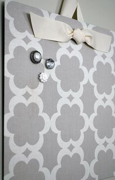 Cover a flat cookie sheet with fabric and you have a cute magnetic board!
