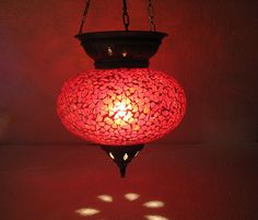 Check out this item in my Etsy shop https://www.etsy.com/listing/260098706/red-mosaic-glass-hanging-lamp-lampe