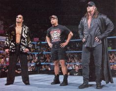 WWE Attitude Era The Rock, Stone Cold Steve Austin and the Undertaker. Or what I like to call them the Trifecta of Awesome!!!!!