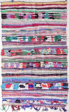 Boucharouette Rugs by ANTIK France  //  In these, often very modest, households, the Berbere women weave carpets out of discarded scraps of material. A thousand scraps of cotton, nylon and occasionally wool are woven into these fabulous decorative creations.