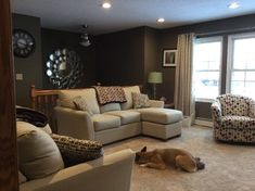 split level living room--I love the wall color and that old trunk in ...