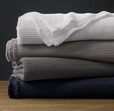 RH's Ribbed Cotton Oversized Bed Throw:Portuguese weavers loom our cotton bed throw with a subtle pattern and delicate raised ribbing for exquisite detail and enhanced texture. It's the perfect lightweight layer to keep at the foot of the bed for cool nights.