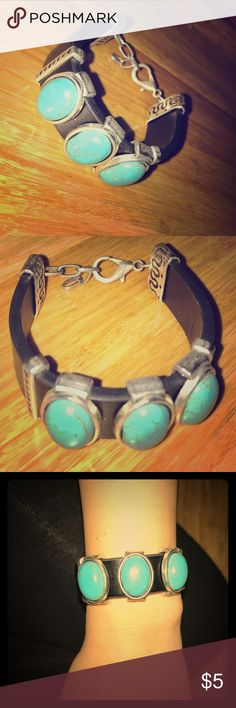 Bracelet Turquoise stone and black 1/2 inch strap with adjustable clamp. Jewelry Bracelets