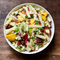 Smoky Heirloom Tomato and Grilled Peach Pasta Salad  - CountryLiving.com