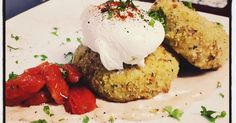 PRAWN & COD CAKES WITH HORSERADISH SAUCE SERVED WITH GRILLED CHERRY TOMATOES