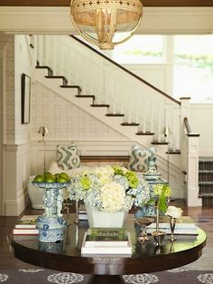 Love the table arrangement and sette/pillows in background.  #foyer, #interiors