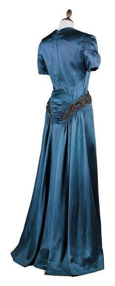 AN EVENING GOWN OF PEACOCK BLUE SATIN ELSA SCHIAPARELLI, 1939-40