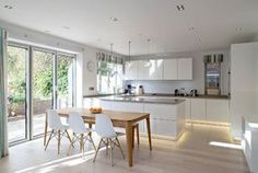 Bright Modern Kitchen With Smooth Lines and a Relaxed Vibe (12...