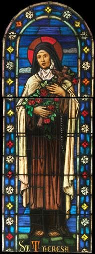Antique Saint Therese Stained Glass Window DESCRIPTION: Antique Saint Therese stained glass window from a Catholic church in Elizabeth, NJ. These windows are extremely high quality and are of the traditional Munich style.