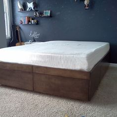 Platform Bed with Drawers - Add a customized headboard and this is exactly what we need for our house