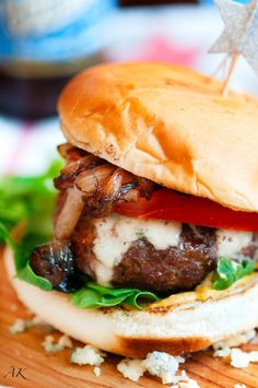Blue cheese burger with caramelized onions and arugula.
