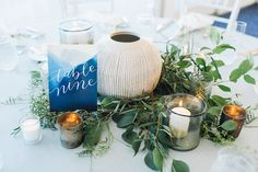 unique table numbers - photo by Cambria Grace Photography http://ruffledblog.com/italian-marbling-inspired-beach-wedding