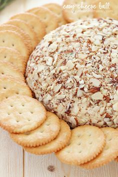 A super easy cheese ball that's sure to impress any guests! It's creamy, tangy and irresistible and won't take more than a few minutes to whip up.