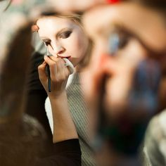 The application of smudge under eyes dusty earthy #smokey eye #makeup backstage at #DVF Fall Winter 2015. #NYFW #FW15 #AW15