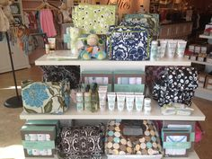 Diaper bag and accessories display table for Bellies by Flourish Design & Merchandising.  Visual Merchandising, display, baby, spring.