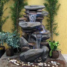 Resultado de imagem para fontes e cascatas para jardim