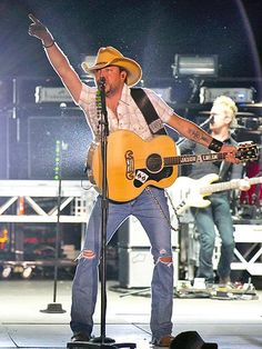 "A guitar-rocking Jason Aldean gets into the ""string"" of things at the  Faster Horses Festival in Brooklyn, Mich. http://www.people.com/people/gallery/0,,20719513,00.html#21366175"