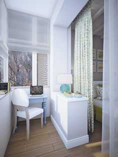 Neat idea if you need to work from home - bright light and a curtain to divide from bedroom.  I like the blue lamp.