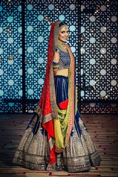 The minimal, monotone lehenga in blue provided the perfect pallette to add colors on the lehenga by using two contrasting dupattas – one in yellow and one in red. Photography by Dotdusk Studios from the Album Band Baja Bride shoot