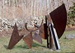 """Symphony, a 78"""" h x 103"""" w x 78"""" d, scrap metal sculpture created by Carole Eisner in 1994"""