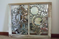 "a ""sandra"" original - creator said she glued mirror directly onto glass then grouted.  very cool"