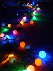 Takee regular Christmas lights and put ping pong balls over them to get this cool effect!