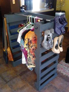 a pallet clothes and Shoe rack