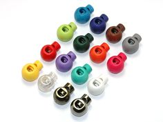 P026 Ball Cord Lock. One Hole, Hole Size 5.5 mm, Height 23.5 mm, Wide 18.4 mm, Thickness 14.5 mm. 17 Color Available.
