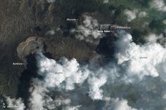 The Earth Observing-1 satellite captured this view of twin lava lakes of Vanuatu's Ambrym volcano. One glowed brightly; the other was capped with a thin gray crust of partially-solid rock.