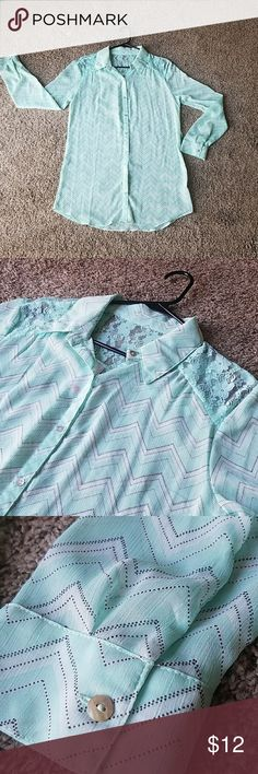 NWT Sea green flowy button down shirt lace blouse New with tags  Collared top with lace detail in shoulders and top of back. Subtle Chevron style print. Flowy material. Has belt loops but no belt. Tops Button Down Shirts