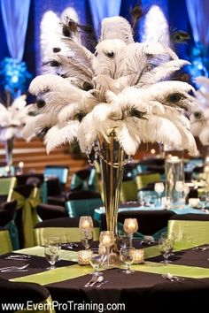 Peacock & Ostrich Feather Centerpiece with gold vase? table clothes in black w/ gold runner or swag?