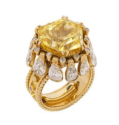 One of the most beautiful and amazing rings I have ever had. It is by Rene Boivin, in 18k gold, with a gorgeous yellow sapphire, and diamond teardrops that fall open and closed when I move my hand. You can have your big diamonds - I'll take this anytime.