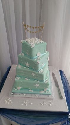 Mint coloured and pure white sea shells wedding cake.