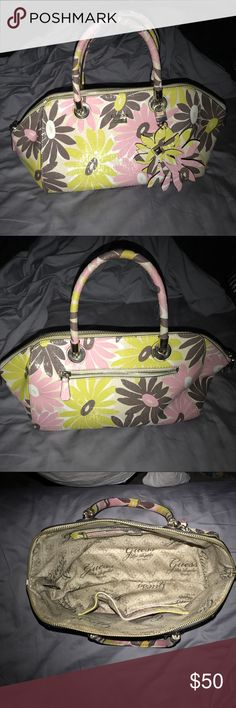 "Guess Jordyn Floral Satchel In excellent condition. Satchel with alluring floral prints and self-trim Double top handles, 5"" drop Adjustable shoulder strap, 22"" drop Goldtone hardware Top zip closure One outside zip pocket One inside zip pocket Three inside slip pockets Lined 11"" X 5"" X 8"" G-shine debossed PVC Guess Bags Satchels"