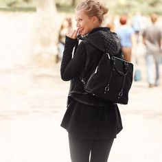 """Take your athleisure game to the next level with this convertible nylon design. Our sporty style goes from classic backpack to office-ready handbag in seconds. Plus, it's the ideal size to carry your gym essentials and everyday must-haves. Convertible backpack Approx. 13"""" x 14.5"""" x 5.5""""; soft goldtone hardware; protective feet Adjustable/removable/convertible straps; outer open pocket; 1 inner open pocket; 1 inner zip pocket Nylon/manmade materials. Dustbag included. Imported Embrace the…"""