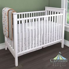 Crib bedding in Solid Silver Gray, Brave Fox, Fox Orange Heather, White and Cloud Gray Classic Herringbone, Silver Gray Flying Arrow. Created using the Nursery Designer® by Carousel Designs where you mix and match from hundreds of fabrics to create your own unique baby bedding. #carouseldesigns