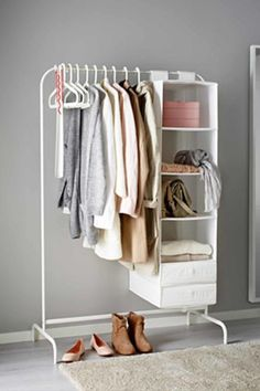 Extend your closet in a spacious bedroom: This cheap clothing rack makes for stylish bedroom decor when you hang up your favorite fashion items. Click through to find more easy closet organization ideas for a small space. Mini Dressing, Dressing Ikea, Dressing Rooms, Closet Bedroom, Closet Space, Clothes Rack Bedroom, Rack For Clothes, Clothes Rail Ikea, Diy Clothes Rack Cheap