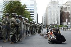 PHILADELPHIA: Protesters sit in a line in front of Pennsylvania National Guard soldiers we...