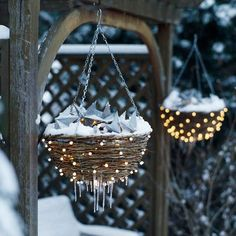 Starry Nights Basket  Make hanging baskets sparkle all winter long by lighting them from within. Use coiled vine baskets without liners, and push a 100-bulb string of small pearl lights from inside to out around each basket. Place clear plastic ornaments in the basket as filler. On top, pile a 50-bulb string of small white lights and a string of prelit metal stars to shine above.