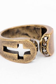Cut the Cross Ring.  http://www.tobi.com/product/44387-bijoux-cut-the-cross-ring?color_id=56547#
