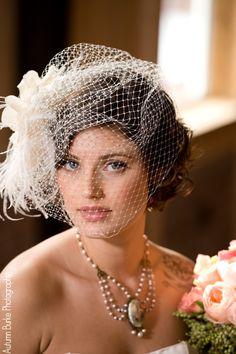 Alisa Benay bird cage veil and jewelry.