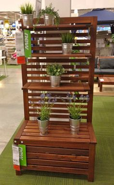 I also liked this APPLARO Bench with Wall Panel and Shelf ($129.96) - a very nice, simple outdoor potting bench.