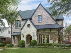 Brick and Stone grace this beautiful traditional in University Park TX