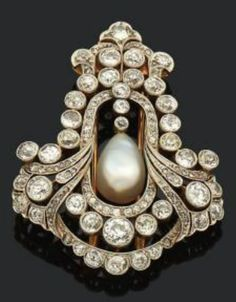 A Belle Epoque yellow gold, platinum, diamond and pearl brooch, Austrian, early 19th century. The openwork brooch with garland, waterfall and foliate motifs centring a pear-shaped pearl and set with old-cut diamonds. Length 5.5cm. #BelleÉpoque #brooch