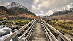 This view of a bridge over Nant Gwern y Gof river with Tryfan mountain in the distance. Bbc News, Railroad Tracks, Wales, Earth, River, Fathers, Bridge, Mountain, Pictures