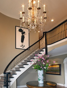 Love large openings and grand staircase when you first walk into a home - although I think there are way too many styles going on here
